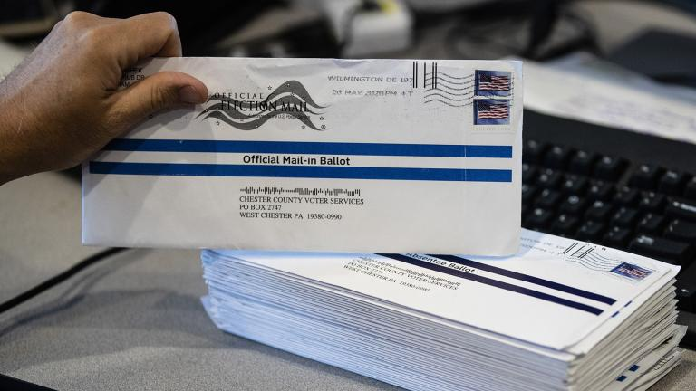 In this May 28, 2020, file photo, mail-in ballots are processed at the Chester County Voter Services office in West Chester, Pa., prior to the primary election. (AP Photo / Matt Rourke, File)