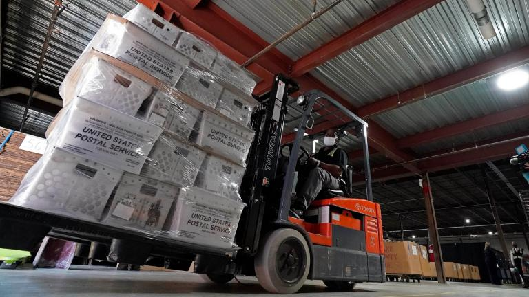 In this Sept. 3, 2020, file photo, a forklift operator loads absentee ballots for mailing at the Wake County Board of Elections as preparations for the upcoming election are ongoing in Raleigh, N.C. (AP Photo / Gerry Broome, File)