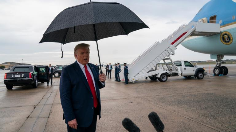 President Donald Trump speaks to reporters at Andrews Air Force Base, Md., as he returns from campaign stops in Florida and Georgia Friday, Sept. 25, 2020. (AP Photo / Evan Vucci)