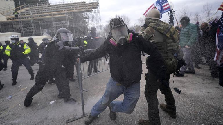 Trump supporters try to break through a police barrier, Wednesday, Jan. 6, 2021, at the Capitol in Washington. (AP Photo / Julio Cortez)
