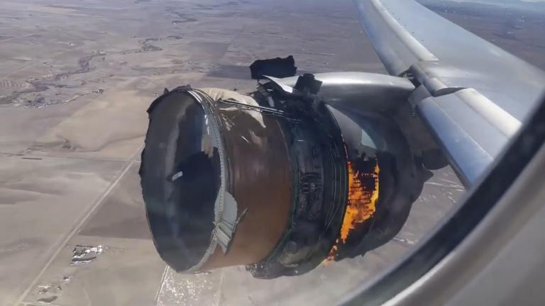 "In this file photo taken from video, the engine of United Airlines Flight 328 is on fire after experiencing ""a right-engine failure"" shortly after takeoff from Denver International Airport, Saturday, Feb. 20, 2021, in Denver, Colo. Two passengers who were on board the United Airlines airplane that had to make an emergency landing are suing the company in separate suits filed Friday, April 16 in Chicago, where United is based. (Chad Schnell via AP, File)"