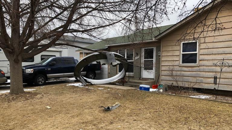 In this photo provided by the Broomfield Police Department on Twitter, debris is scattered in the front yard of a house at near 13th and Elmwood, Saturday, Feb. 20, 2021, in Broomfield, Colo. (Broomfield Police Department via AP)