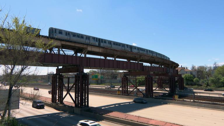 At about 59th Street, just north of where the Skyway splits off from the Dan Ryan, motorists pass beneath a bridge that carries the Green Line seemingly way, way up in the air. (WTTW News)
