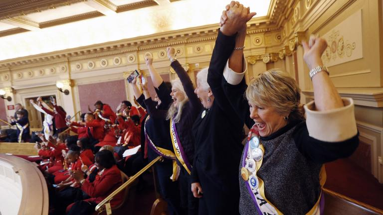 In this Monday, Jan. 27, 2020 file photo, Equal Rights Amendment supporter Donna Granski, right, from Midlothian Va., cheers the passage of the House ERA Resolution in the Senate chambers at the Capitol in Richmond, Va. (AP Photo / Steve Helber, File)