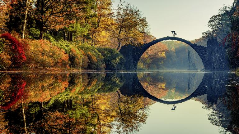 Lorenz Holder of Germany was the overall winner of the 2016 Red Bull Illume contest. The photo shows Senad Grosic ride his bike over a bridge in an autumnal Gablenz, Germany. (Lorenz Holder / Red Bull Illume)