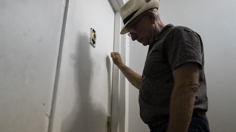 Gary Zaremba knocks on an apartment door as he checks in with tenants to discuss building maintenance at one of his at properties, Thursday, Aug. 12, 2021, in the Queens borough of New York. (AP Photo / John Minchillo)
