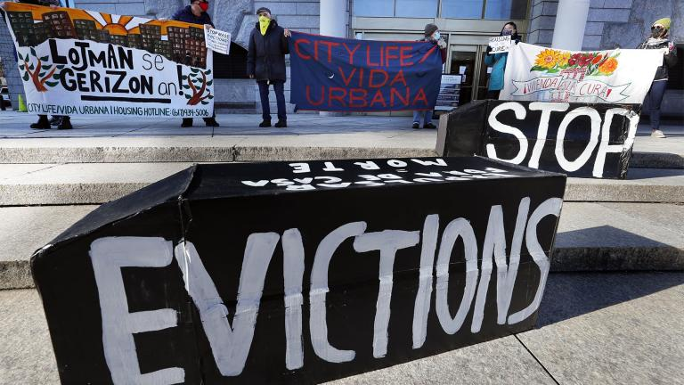 FILE - In this Jan. 13, 2021, file photo, tenants' rights advocates demonstrate in front of the Edward W. Brooke Courthouse in Boston. (AP Photo / Michael Dwyer, File)