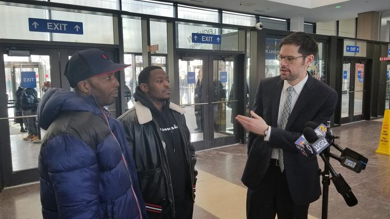 Attorney Joel Flaxman, right, stands inside the Leighton Criminal Court Building with Jermaine Colmaine, center, and Germain Sims on Wednesday, Feb. 13, 2019. (Matt Masterson / Chicago Tonight)