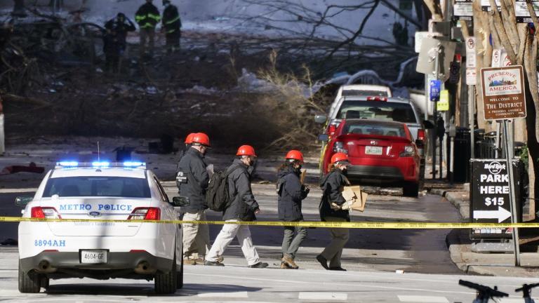 Investigators walk near the scene of an explosion Saturday, Dec. 26, 2020, in Nashville, Tenn. (AP Photo / Mark Humphrey)