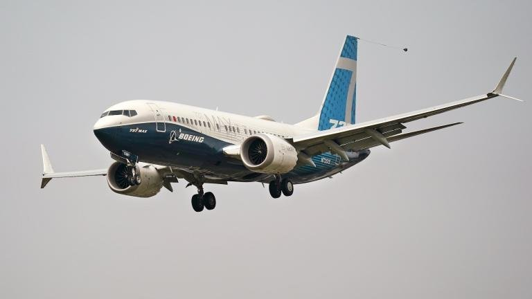 In this Wednesday, Sept. 30, 2020, file photo, a Boeing 737 Max jet, piloted by Federal Aviation Administration Chief Steve Dickson, prepares to land at Boeing Field following a test flight in Seattle. (AP Photo/Elaine Thompson, File)