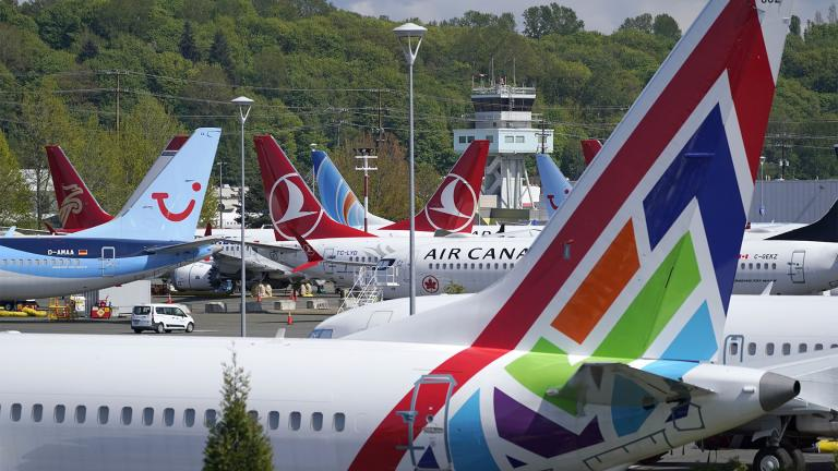 Boeing 737 Max airplanes sit parked in a storage lot, Monday, April 26, 2021, near Boeing Field in Seattle. (AP Photo / Ted S. Warren)