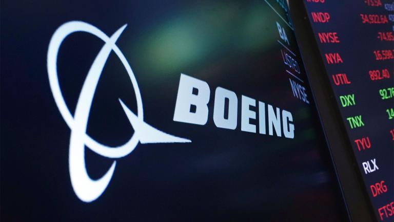 The logo for Boeing appears on a screen above a trading post on the floor of the New York Stock Exchange, Tuesday, July 13, 2021. (AP Photo / Richard Drew, file)