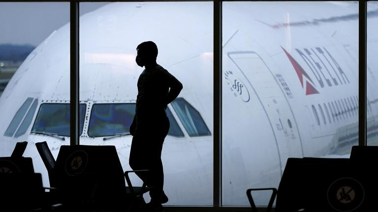 In this Feb. 18, 2021 file photo, a passenger wears a face mask to help prevent the spread of the new coronavirus as he waits for a Delta Airlines flight at Hartsfield-Jackson International Airport in Atlanta. (AP Photo / Charlie Riedel, file)