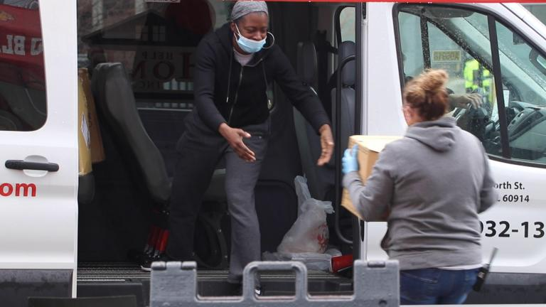 Supplies to fight the spread of COVID-19 are donated at United Center on Saturday, April 25, 2020 in Chicago. The city started a face mask drive before a statewide order requiring face coverings in public takes effect May 1. (Evan Garcia / WTTW News)