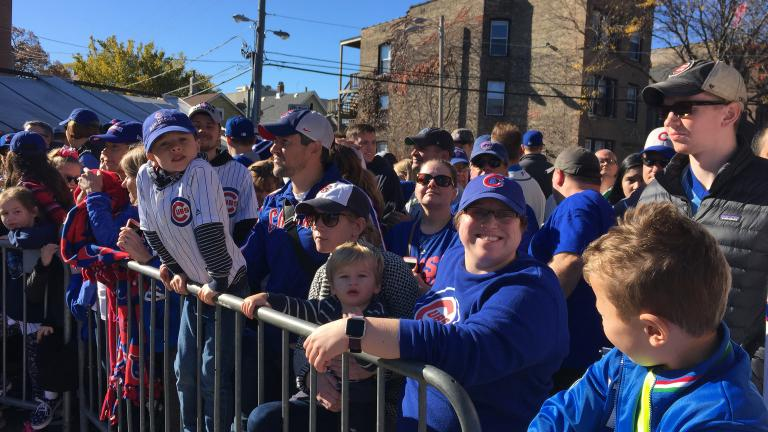 Cubs fans line Waveland Avenue for a chance to see the World Series champs Friday morning. (Evan Garcia / Chicago Tonight)