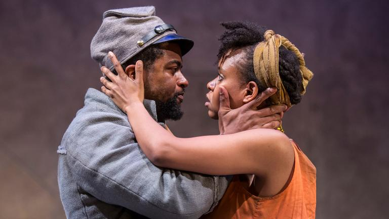 "Kamal Angelo Bolden and Aimé Donna Kelly in the Chicago premiere of ""Father Comes Home from the Wars (Parts 1, 2 & 3)"" by Suzan-Lori Parks. (Credit: Liz Lauren)"