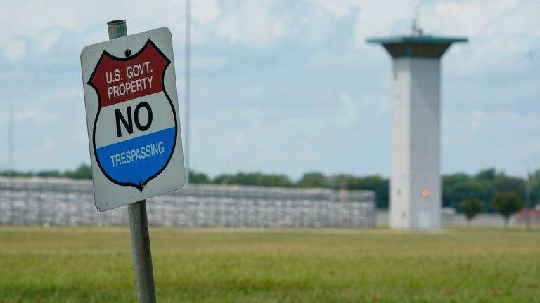 In this Aug. 28, 2020, file photo, a no trespassing sign is displayed outside the federal prison complex in Terre Haute, Ind. (AP Photo / Michael Conroy, File)