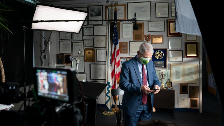 """This image released by National Geographic shows Dr. Anthony Fauci at the NIH in Bethesda, Md., during the filming of the documentary """"Fauci."""" (Visko Hatfield / National Geographic via AP)"""