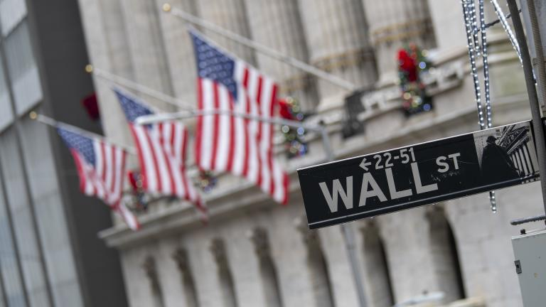 In this Jan. 3, 2020 file photo, the Wall St. street sign is framed by American flags flying outside the New York Stock Exchange in New York. Stocks are falling early on Wall Street Thursday, Sept. 17, as the late selling from the previous day carries over. (AP Photo/Mary Altaffer, File)