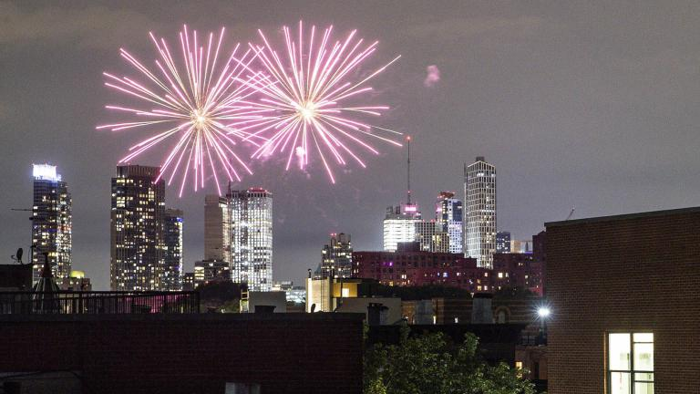 In this Friday, June 19, 2020 photo, fireworks explode during Juneteenth celebrations above the Bedford-Stuyvesant neighborhood in the Brooklyn borough of New York. (AP Photo / John Minchillo, File)