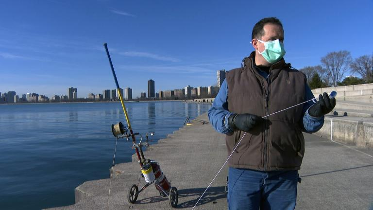 Florin Deleanu powerline fishes at Montrose Harbor in Chicago on March 12, 2021. (WTTW News)