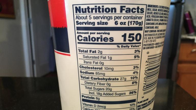 A nutrition fact label for vanilla yogurt shows a 6-ounce serving contains 20 grams of sugar – of which 18 grams are added sugars. (Kristen Thometz / WTTW News)