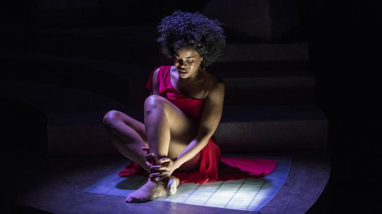 "AnJi White in Court Theatre's production of ""For Colored Girls Who Have Considered Suicide/When the Rainbow Was Enuf."" (Photo by Michael Brosilow)"