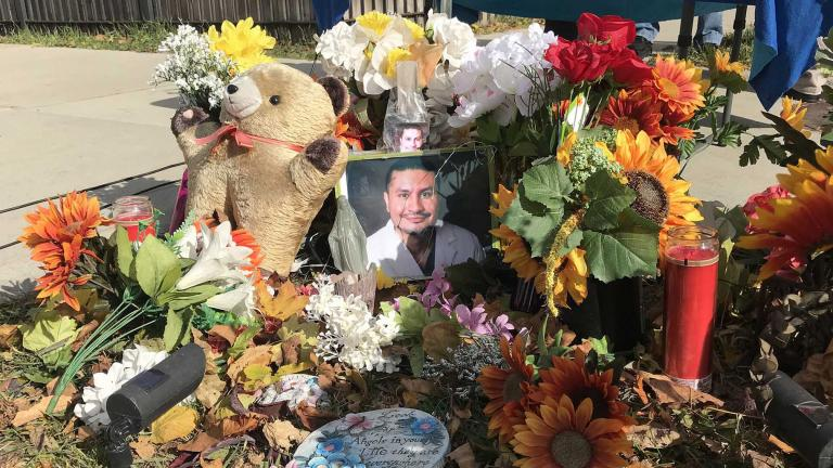 The family of Frank Aguilar added new flowers and a new photo to his memorial at the corner of South Hamlin and West 32nd Street to honor his life on Sunday, Nov. 1, 2020, the eve of Day of the Dead. (Ariel Parrella-Aureli / WTTW News)