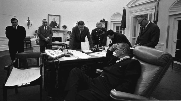 President Lyndon B. Johnson, seated, discusses the 1967 Detroit riot with members of his staff in the Oval Office. (LBJ Library photo by Yoichi Okamoto)