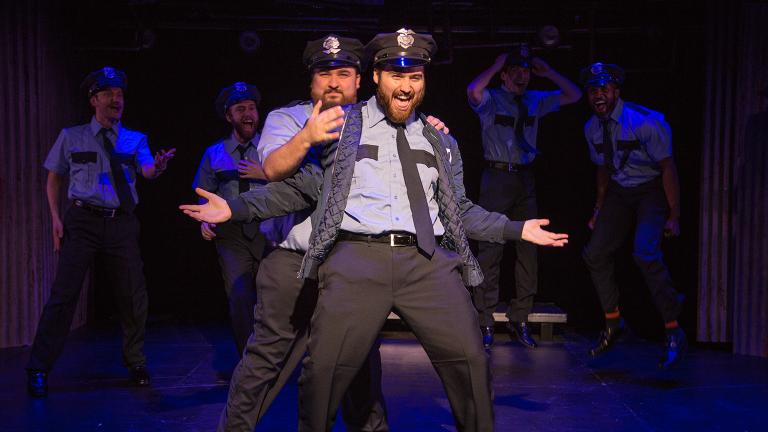 """The Full Monty"" at Theo Ubique Cabaret Theatre. Front: Nick Druzbanski, left, and Matt Frye. Background, from left: Jonathan Schwart, Neil Stratman, Joe Giovannetti and Marc Prince. (Photo by Austin D. Oie)"