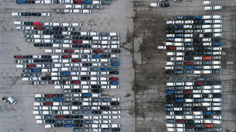 In this aerial photo, mid-sized pickup trucks and full-size vans are seen in a parking lot outside a General Motors assembly plant where they are produced Wednesday, March 24, 2021, in Wentzville, Mo. (AP Photo / Jeff Roberson)