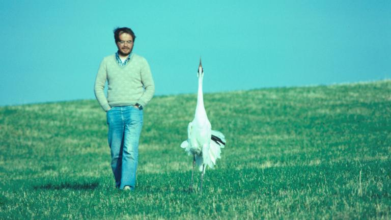 Conservationist George Archibald and a crane named Tex. (Photo courtesy of the International Crane Foundation)
