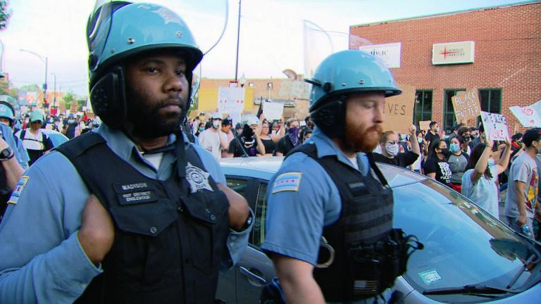 Chicago police officers and demonstrators make their way along city streets during one of many protests sparked by the 2020 police killing of George Floyd. (WTTW News)