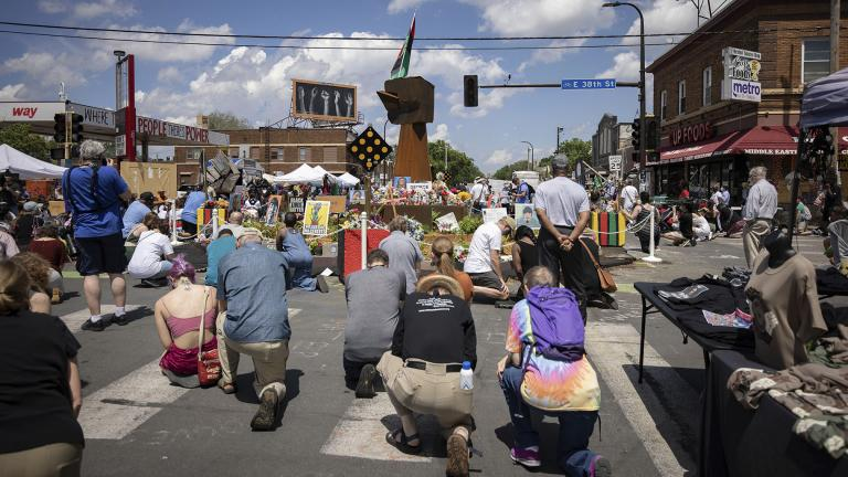 People take a knee during a moment of silence on the one year anniversary of George Floyd's death on Tuesday, May 25, 2021, in Minneapolis, Minn. (AP Photo / Christian Monterrosa)