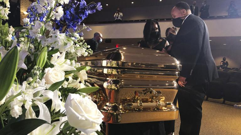 Martin Luther King III takes a moment by George Floyd's casket Thursday, June 4, 2020, before a memorial service for George Floyd in Minneapolis. (AP Photo / Bebeto Matthews)