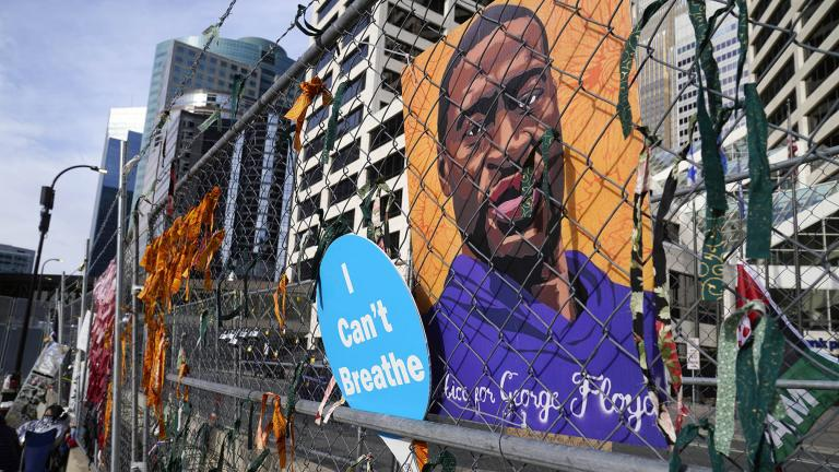 A picture of George Floyd hangs on a fence outside the Hennepin County Government Center, Tuesday, March 30, 2021, in Minneapolis where the trial for former Minneapolis police officer Derek Chauvin continues. (AP Photo / Jim Mone)