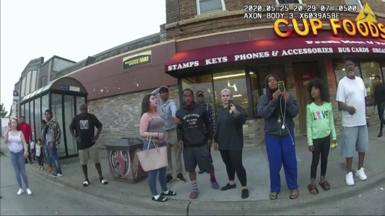 This image from a police body camera shows people gathering as former Minneapolis police officer Derek Chauvin was recorded pressing his knee on George Floyd's neck for several minutes as onlookers yelled at Chauvin to get off and Floyd saying that he couldn't breathe on May 25, 2020 in Minneapolis. (Minneapolis Police Department via AP)