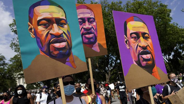 In this Aug. 28, 2020, file photo, people carry posters with George Floyd on them as they march from the Lincoln Memorial to the Martin Luther King Jr. Memorial in Washington. (AP Photo / Carolyn Kaster, File)