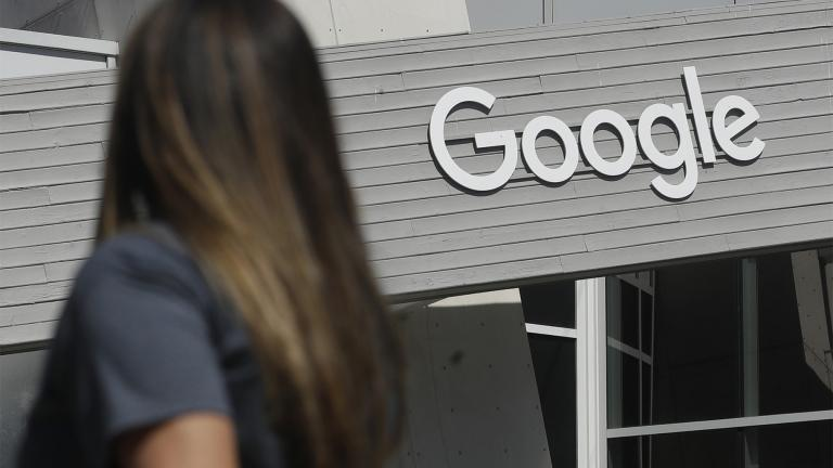 In this Sept. 24, 2019, file photo, a woman walks below a Google sign on the campus in Mountain View, Calif. (AP Photo / Jeff Chiu, File)