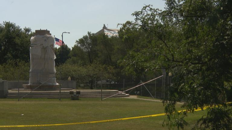 An empty pedestal in Grant Park where a statue of Christopher Columbus stood. (WTTW News)