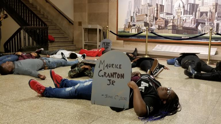 "Chicago teens hold a three-minute ""die-in"" at City Hall on Monday, June 11 in remembrance of Maurice Granton Jr. and others killed by the Chicago Police Department. (Matt Masterson / Chicago Tonight)"