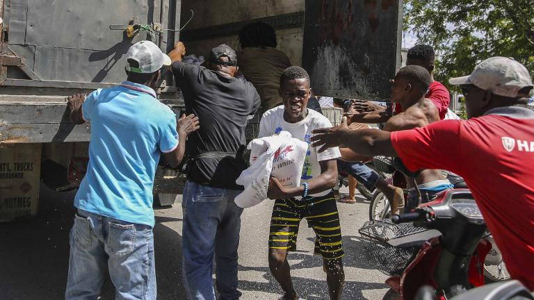 Rice is distributed to residents in Les Cayes, Haiti, Monday, Aug. 16, 2021, two days after a 7.2-magnitude earthquake struck the southwestern part of the hemisphere's poorest nation on Aug. 14. (AP Photo / Joseph Odelyn)