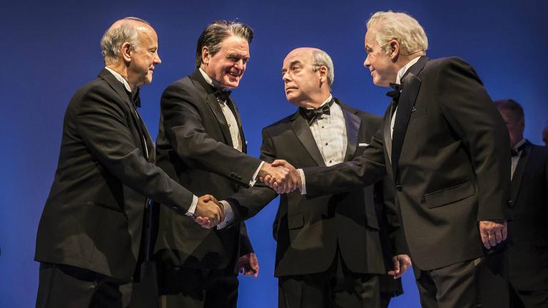 "Jim Ortlieb (George Shultz), Rob Riley (Ronald Reagan), William Dick (Mikhail Gorbachev), and Steve Pickering (Eduard Shevardnadze) in ""Blind Date"" by Rogelio Martinez. (Liz Lauren / Goodman Theatre)"