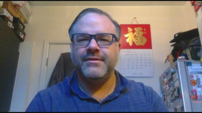 """Josh Blue, a vice principal at English Schools Foundation Kennedy School in Hong Kong, speaks with """"Chicago Tonight"""" via Zoom on Monday, April 13, 2020. (WTTW News)"""