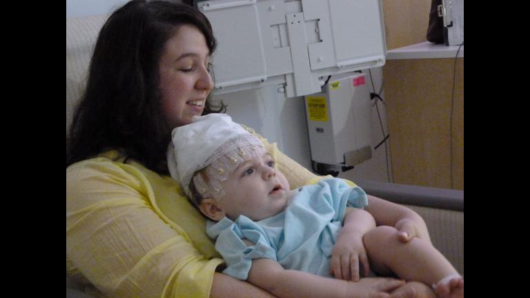 Ellen Wehrman and her son, Charlie, spend his first birthday preparing for an EEG. Wehrman, a former Loyola University Chicago student activities coordinator, will receive an award this week for raising awareness of infantile spasms, a rare disorder. (Courtesy Ellen Wehrman)
