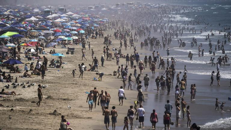 In this Saturday, Sept. 5, 2020 file photo, people crowd the beach in Huntington Beach, Calif., as the state swelters under a heat wave. (AP Photo / Jae C. Hong)