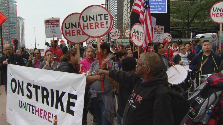 Hotel workers strike in front of the Hyatt Regency Chicago on Monday, Oct. 1, 2018.