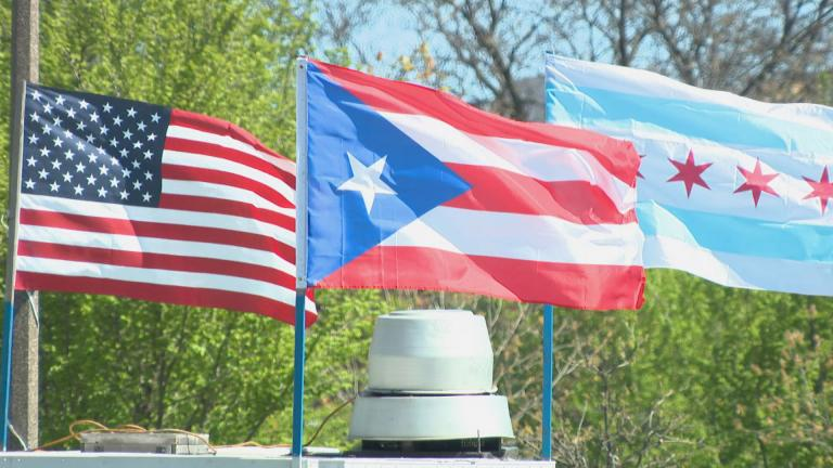 The flag of Puerto Rico flies alongside the U.S. flag and Chicago flag in Humboldt Park. (WTTW News)