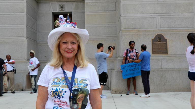 """Joy Williams, a Hillary Clinton supporter and delegate from Mississippi, stands outside Philadelphia City Hall. """"Since Bernie didn't carry the primary, his supporters need to unite,"""" Williams said. (Evan Garcia / Chicago Tonight)"""