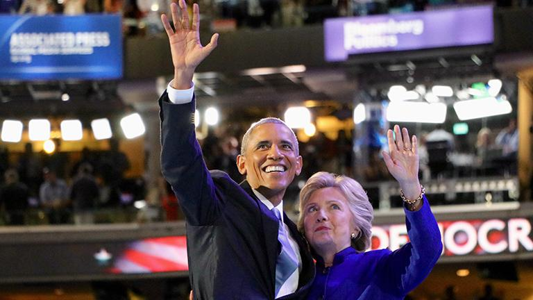 President Barack Obama and Democratic presidential nominee Hillary Clinton waving to the crowd as they exit the stage. (Evan Garcia / Chicago Tonight)